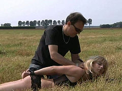 Blonde spanked and fucked on the open field