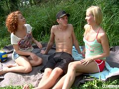 Picnic threesome with his two beautiful teenage cock lovers