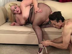 BBW blonde in a fishnet bodysuit getting her fat pussy fucked