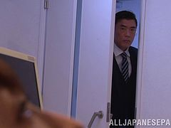 Attractive Japanese dame giving superb blowjob in the office in close up shoot