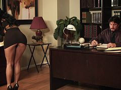 A guy fucks his hot cougar secretary on his desk in the office