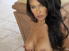 Endearing dame with dark hair unpinning her bra showcasing her big tits