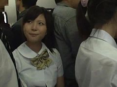 Japanese student gets naughty with a stranger in a bus