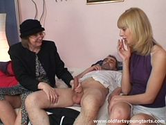 Seductive granny is involved in a smashing hot FFM threesome