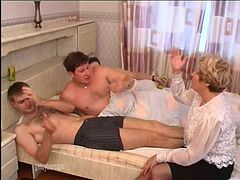 In the bedroom she is triple fucked by three hung guys