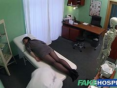 Brunette girl plays doctors massage toy