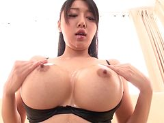 Japanese beauty with big round melons masturbates solo