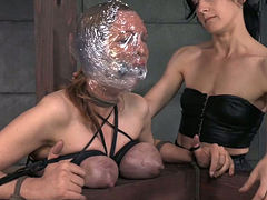 Wrapped in plastic brunette gets her muff punished with multiple orgasm