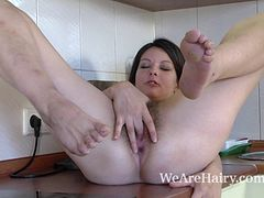 Farida gets naked in kitchen and masturbates