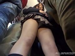 Japanese teen in school uniform sucks dicks in a bus