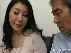 Dildoing the delicious pink tato of a Japanese MILF