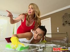 Strict blonde MILF makes her lesbian teen house cleaner lick her cunt