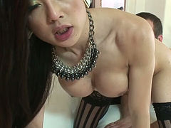Asian ladyboy rides her lover's meat stick while jerking off