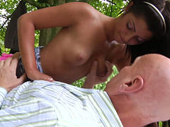 Fresh and young hottie fucks an old guy in the park outdoor