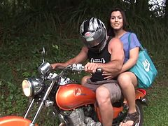 Biker dude fucking a gorgeous tranny's asshole outdoors
