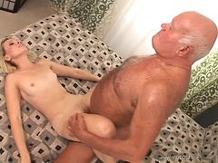 Gina rides a short fat cock of an old man after sucking it