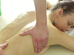 Horny masseur teases oiled bootyful brunette gal with massage and pussy tickling
