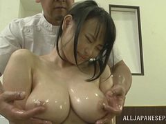 Immaculate Asian babe stimulated as she gets oiled and massaged
