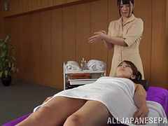 Enchanting lesbian giving her babes massage before enjoying her pussy being fingered