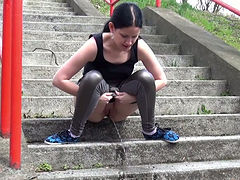 Raven haired filthy girl finds pissing on stairs very captivating