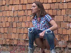 Whorish brunette sweetie made a lot piss near brick fence