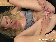 Horny blondie is going to piss after masturbation