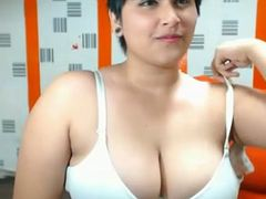 Short-haired webcam beauty is damn proud of her big boobies