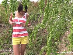 Teen takes a quick piss and masturbates lustily outdoors