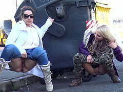 Duo of filthy sex dolls piss near roadside trash box