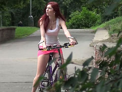 Red haired biker girlie in pink mini skirt pisses on sidewalk