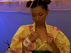 Busty Japanese teen in yellow kimono strips and teases