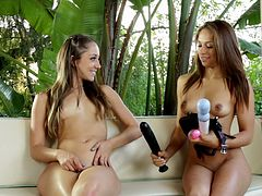 A hot lesbian couple gets out the oil and the strapon and play