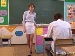 Asian dame in miniskirt yelling as her hairy pussy is fingered  in reality shoot