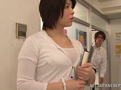 Asian teacher giving her student stunning titjob in the classroom