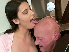 Shapely and buxom brunette babe sucks the old dick like mad