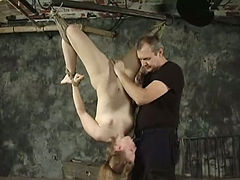 Impossibly horny slut is hanging upside down in hot BDSM clip