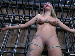 Buxom hogtied blondie in red dress gets metal hook in her asshole