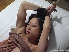 Robe bondage and piercing BDSM play with an Asian girl