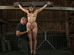 Dark-haired nympho is all tied up and ready for any kind of punishment