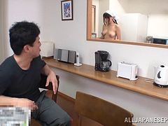 Sexy Japanese cook gives a blowjob and a titjob in the kitchen