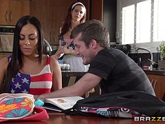 Housewife and a hottie share a big cock in a sexy threesome