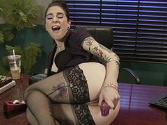 Tattooed Joanna Angel is playing with toys