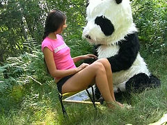Charming brunette teen having dirty sex with dude in a panda costume in the forest