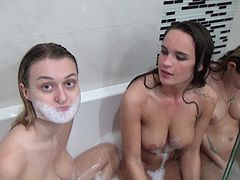 Three girls have soapy, sexy fun playing in the bath tub