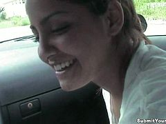 Nasty brown-haired chick gives a blowjob to her BF in a car