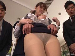 Pantyhose wearing Asian slut receives a huge facial