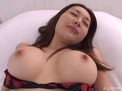 Busty Asian pornstar gives a sizzling after having her tits fondled