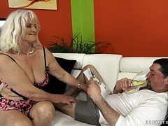 Blonde granny Judi blows and takes a ride on a cock