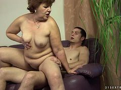 Dark-haired granny Caitlin sucks a dick and jumps on it wildly