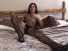 Brunette cougar in high heels striping showcasing her nice ass on bed